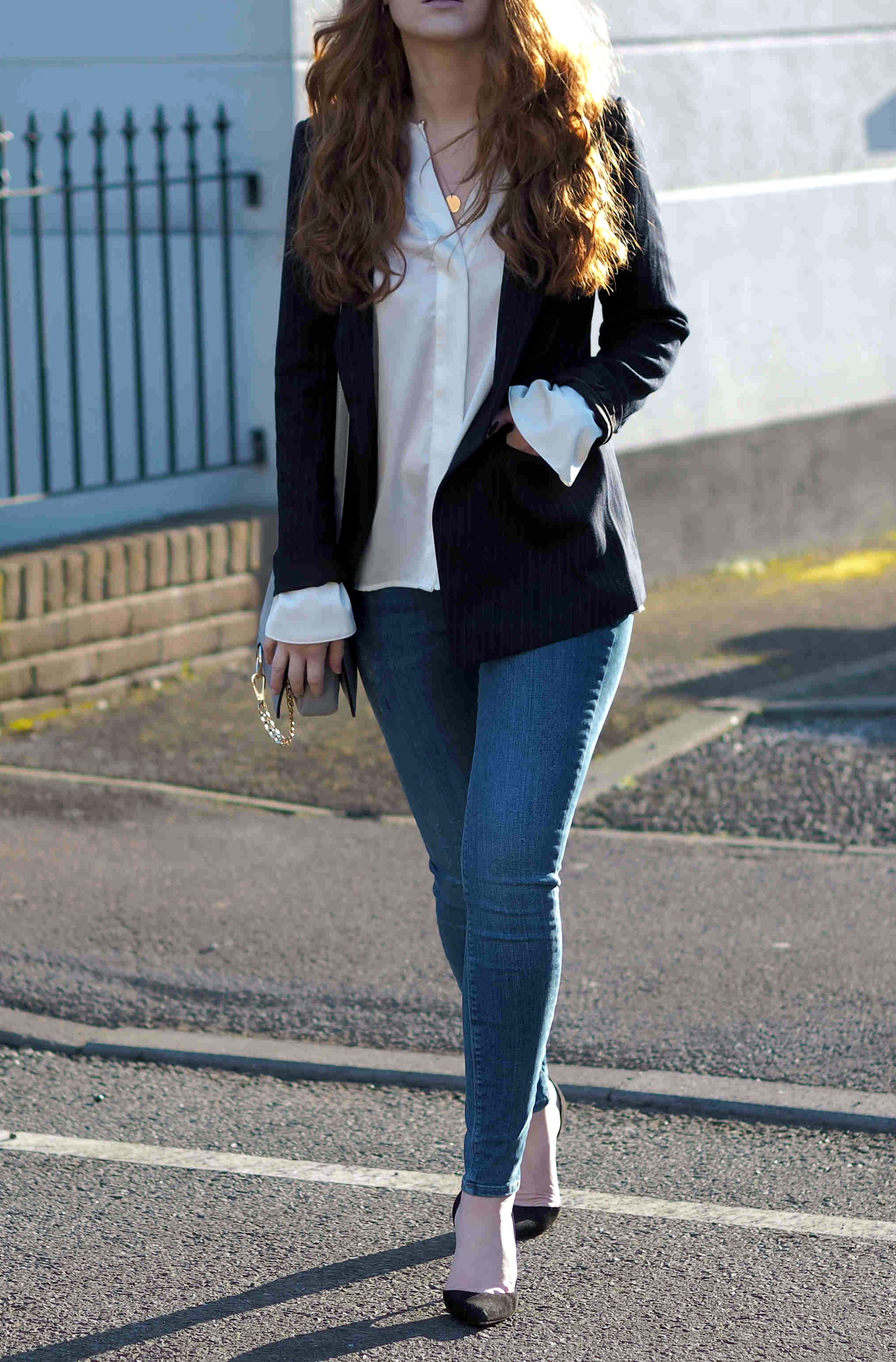 h&m pinstripe navy blazer with zara satin white blouse mango heels and river island blue jeans smart casual outfit inspiration