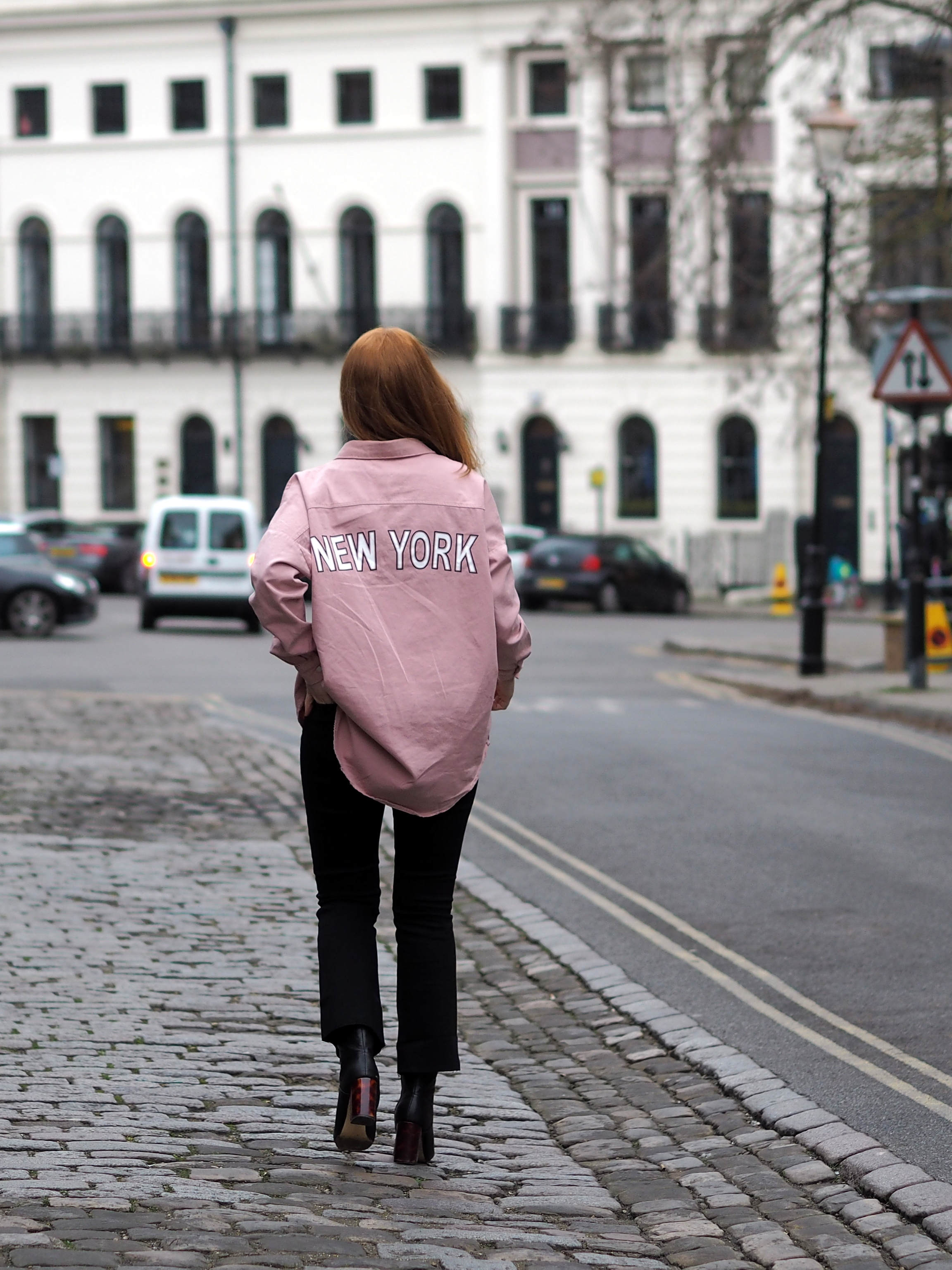 Styling the Pink trend with an oversized pink denim shirt with 'New York' slogan from Missguided, paired with kick flare jeans
